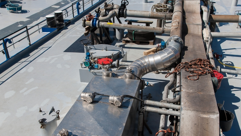 Bunker fuel metering system installed on a barge